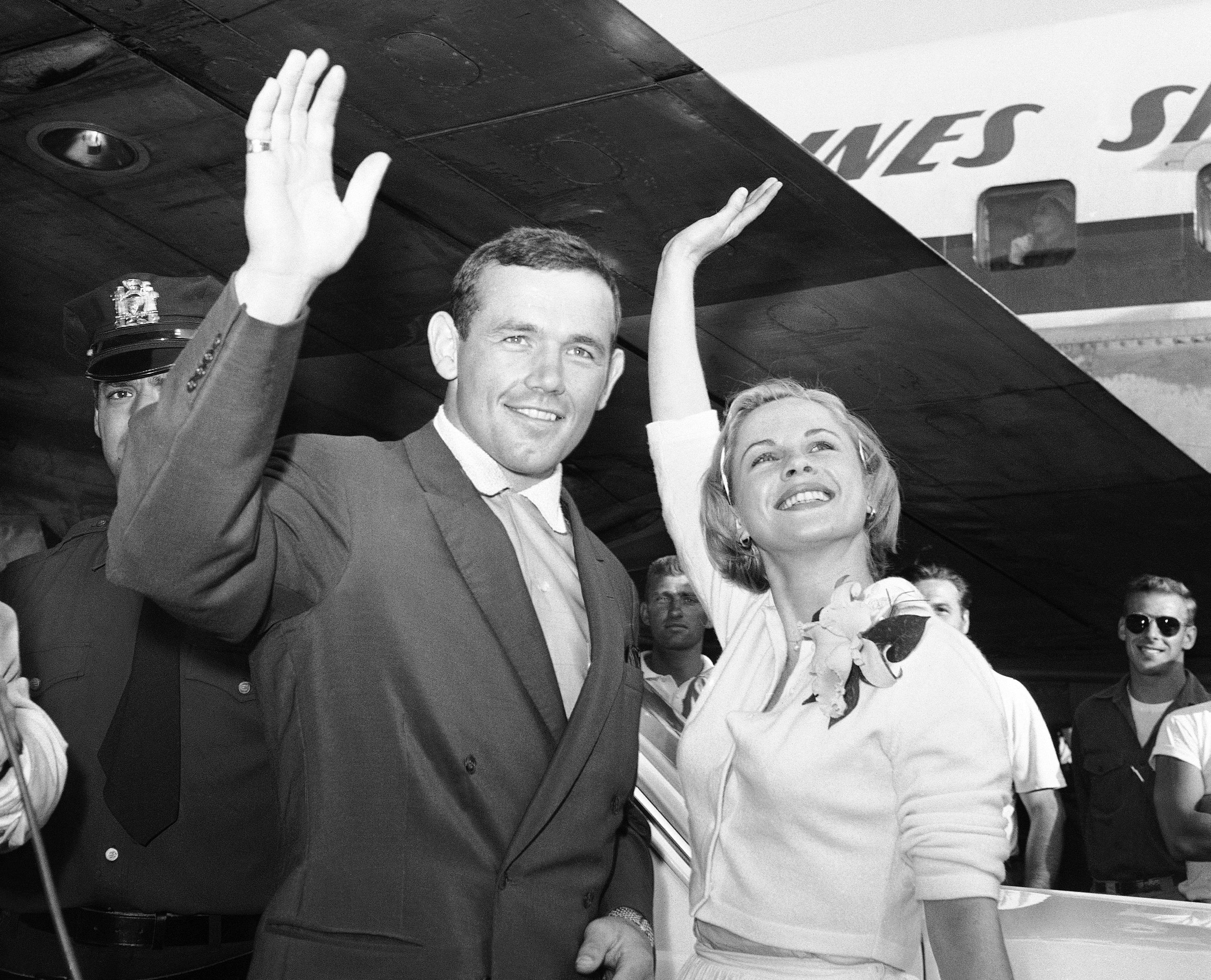 FILE - In this July 3, 1959 file photo, Swedish actress Bibi Andersson, right, and Sweden's Ingemar Johansson wave for the photographers at New York's Idlewild Airport.(AP Photo/Hans von Nolde, File)