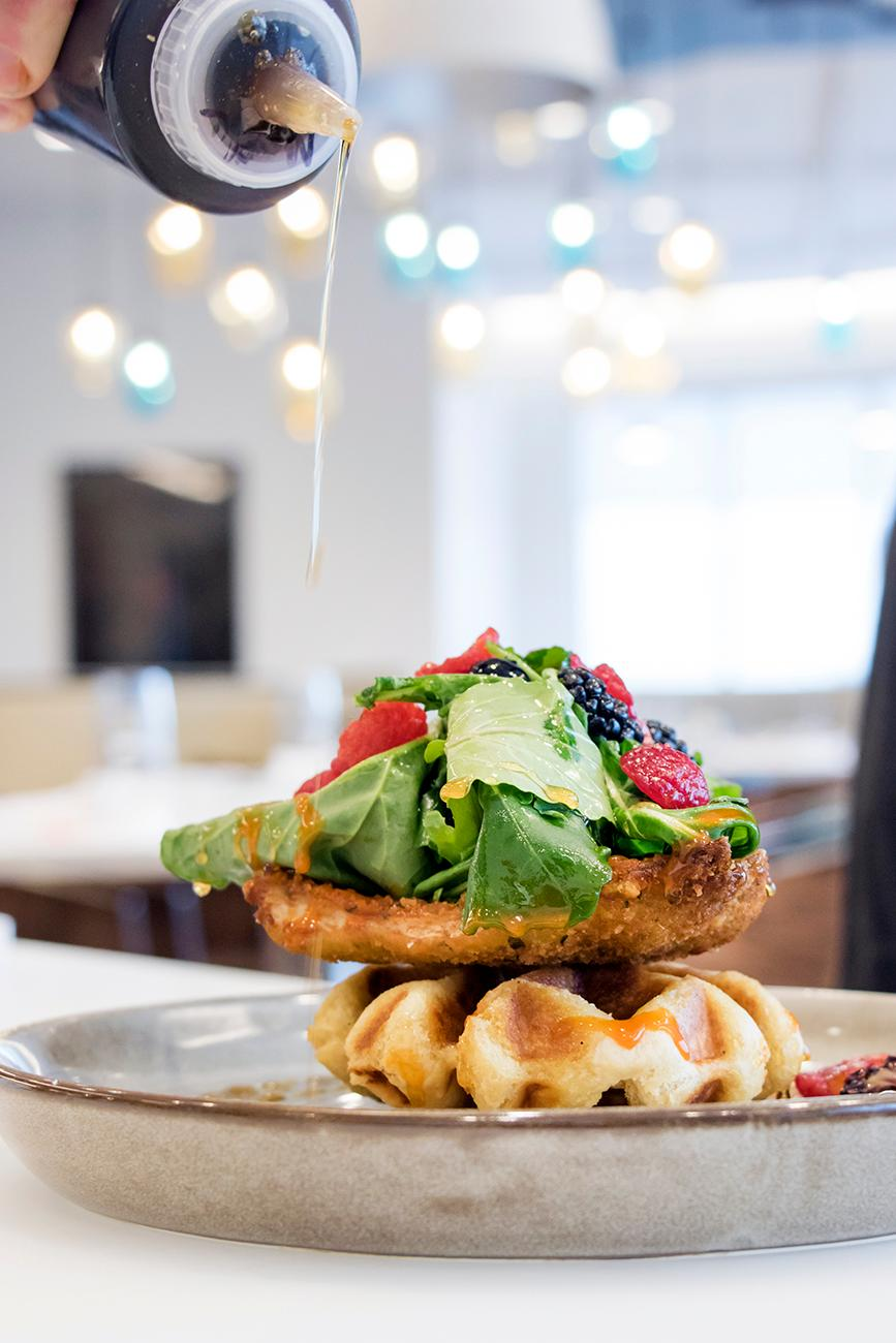 <p>Chicken and waffles drizzled with local honey / Image: Allison McAdams // Published: 5.11.18</p>