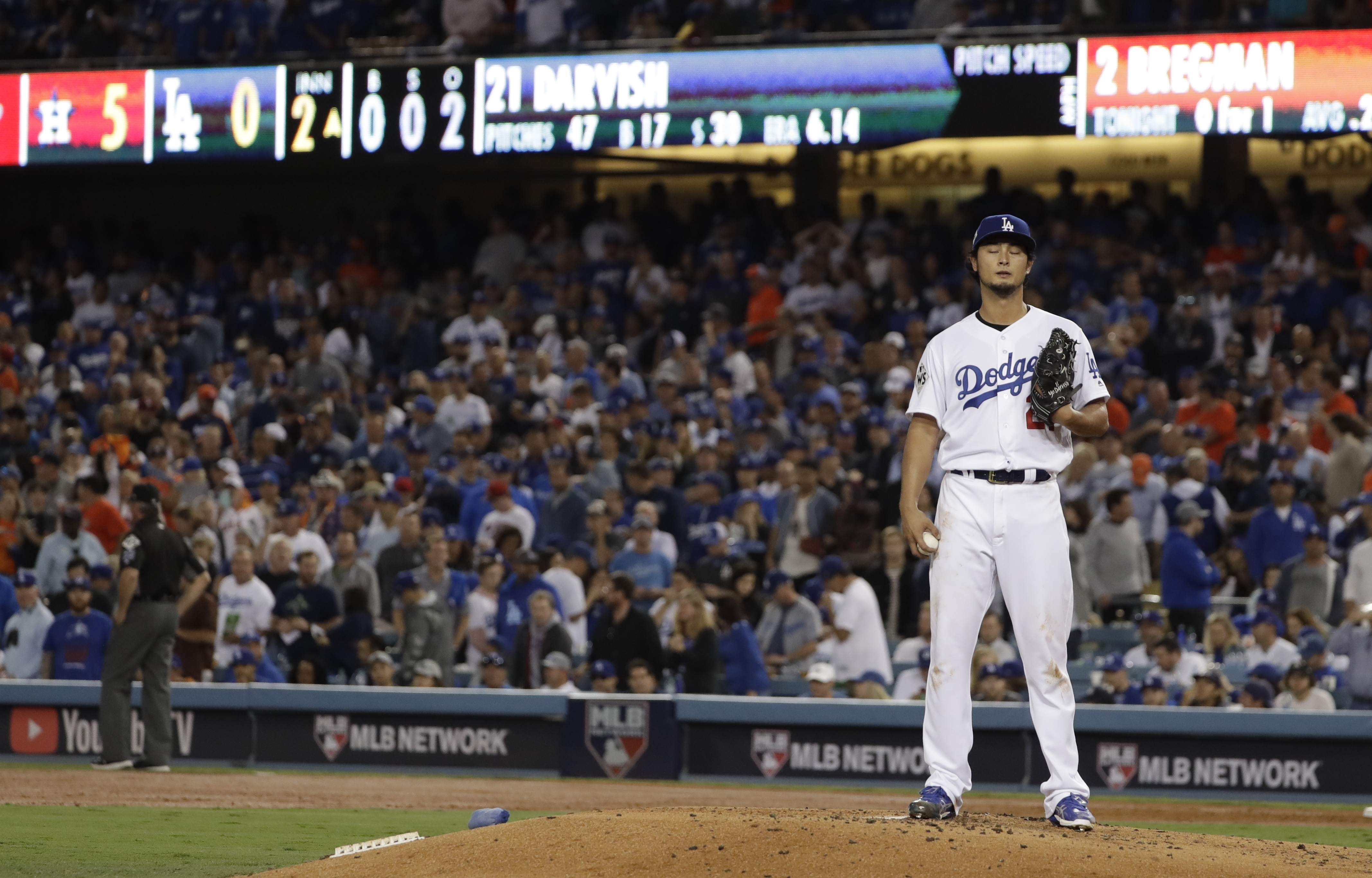 Los Angeles Dodgers' Yu Darvish reacts after giving up a two-run home run to Houston Astros' George Springer during the second inning of Game 7 of the World Series Wednesday, Nov. 1, 2017, in Los Angeles. (AP Photo/Matt Slocum)