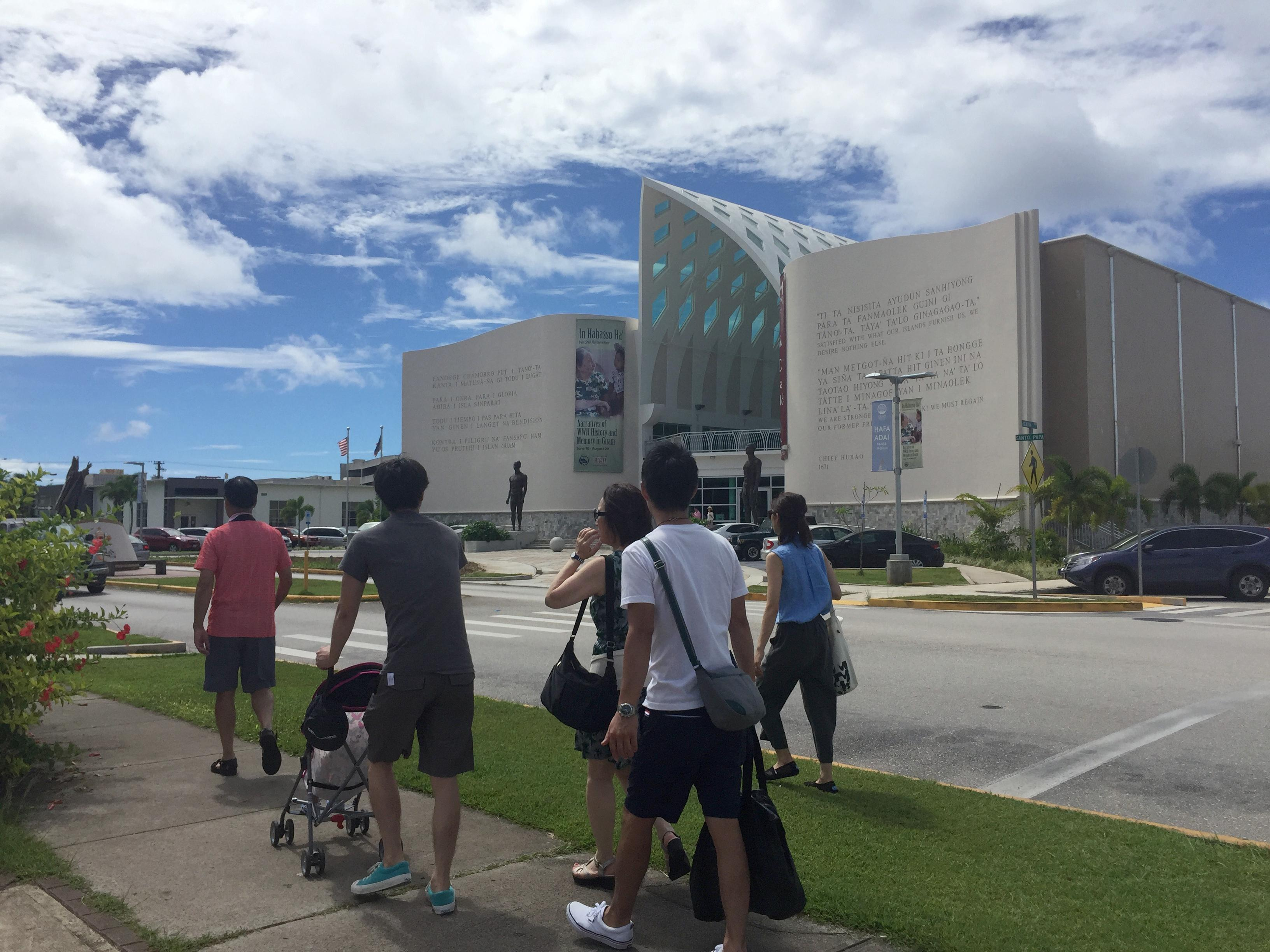People walk around Hagatna, Guam Wednesday, Aug. 9, 2017. Despite government assurances, residents of the U.S. territory Guam say they're afraid after being caught in the middle of rising tensions between President Donald Trump and North Korea. (AP Photo/Grace Garces Bordallo)
