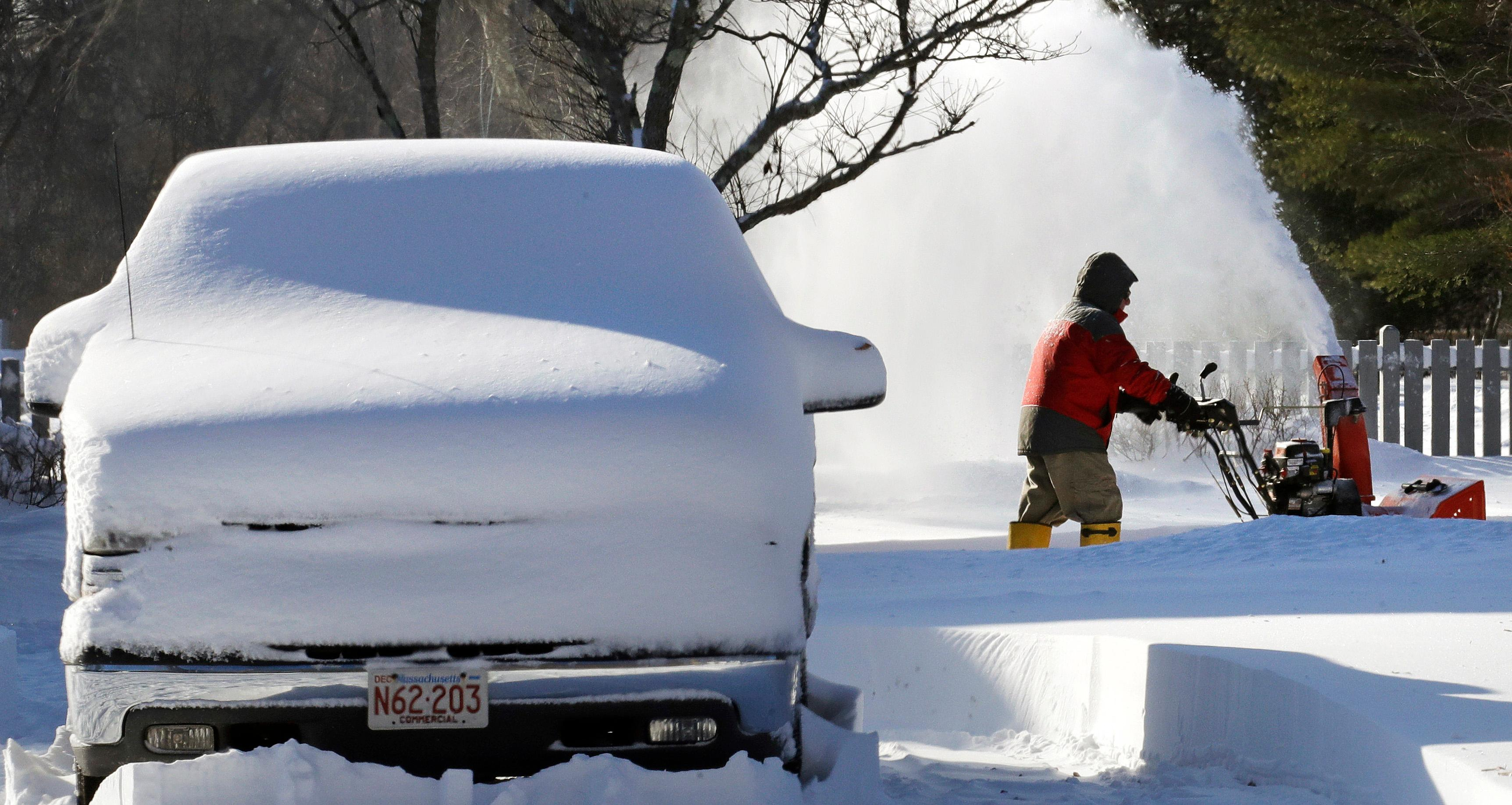 Eugene Mullen clears his driveway in Norwell, Mass., Friday, Jan. 5, 2018. Frigid temperatures, some that could feel as cold as minus 30 degrees, moved across the East Coast on Friday as the region attempted to clean up from a massive winter storm. (AP Photo/Charles Krupa)