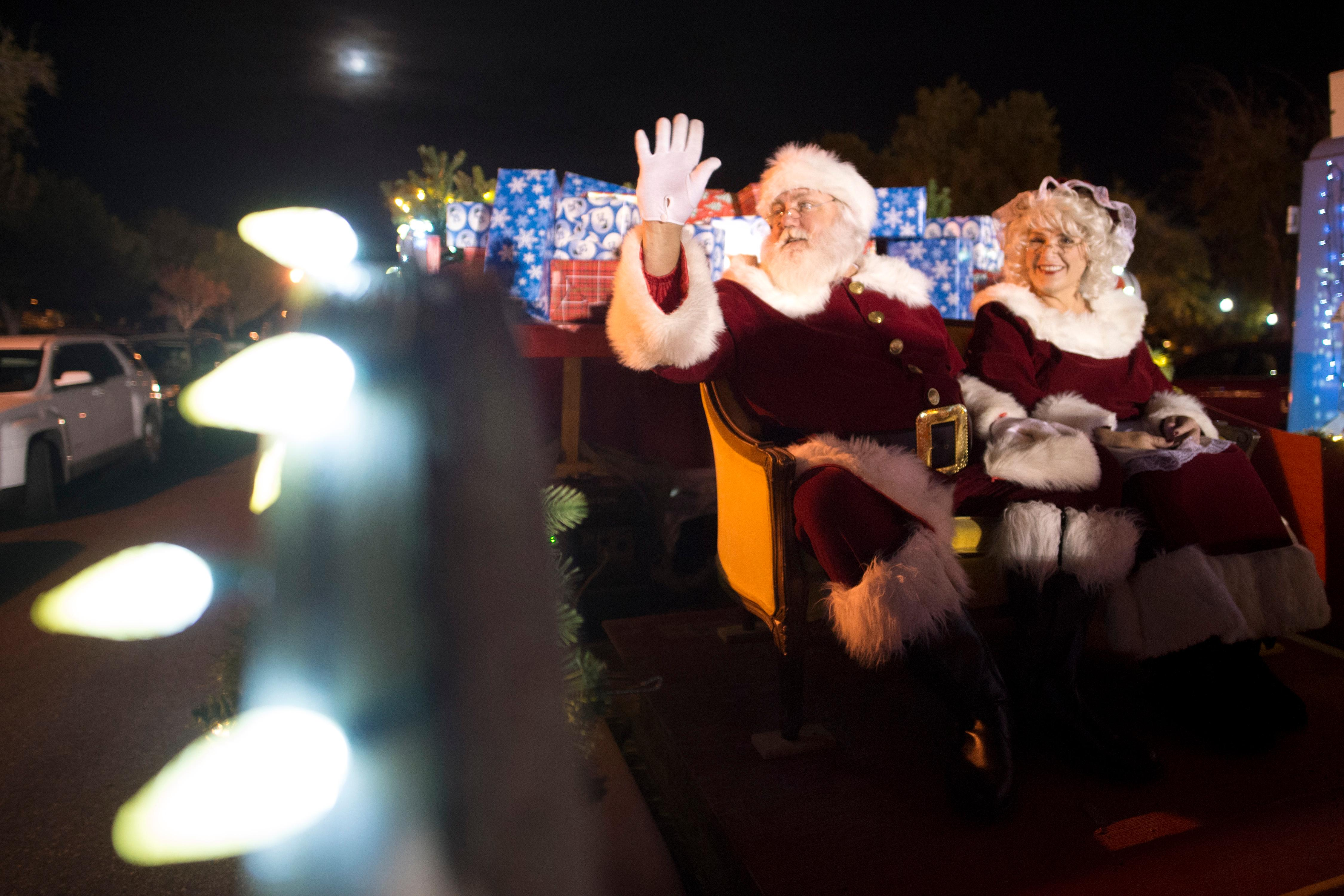 Santa and Mrs. Claus wave from their float during the Santa's Electric Parade Saturday, December 2, 2017, in Boulder City. [Sam Morris/Las Vegas News Bureau]