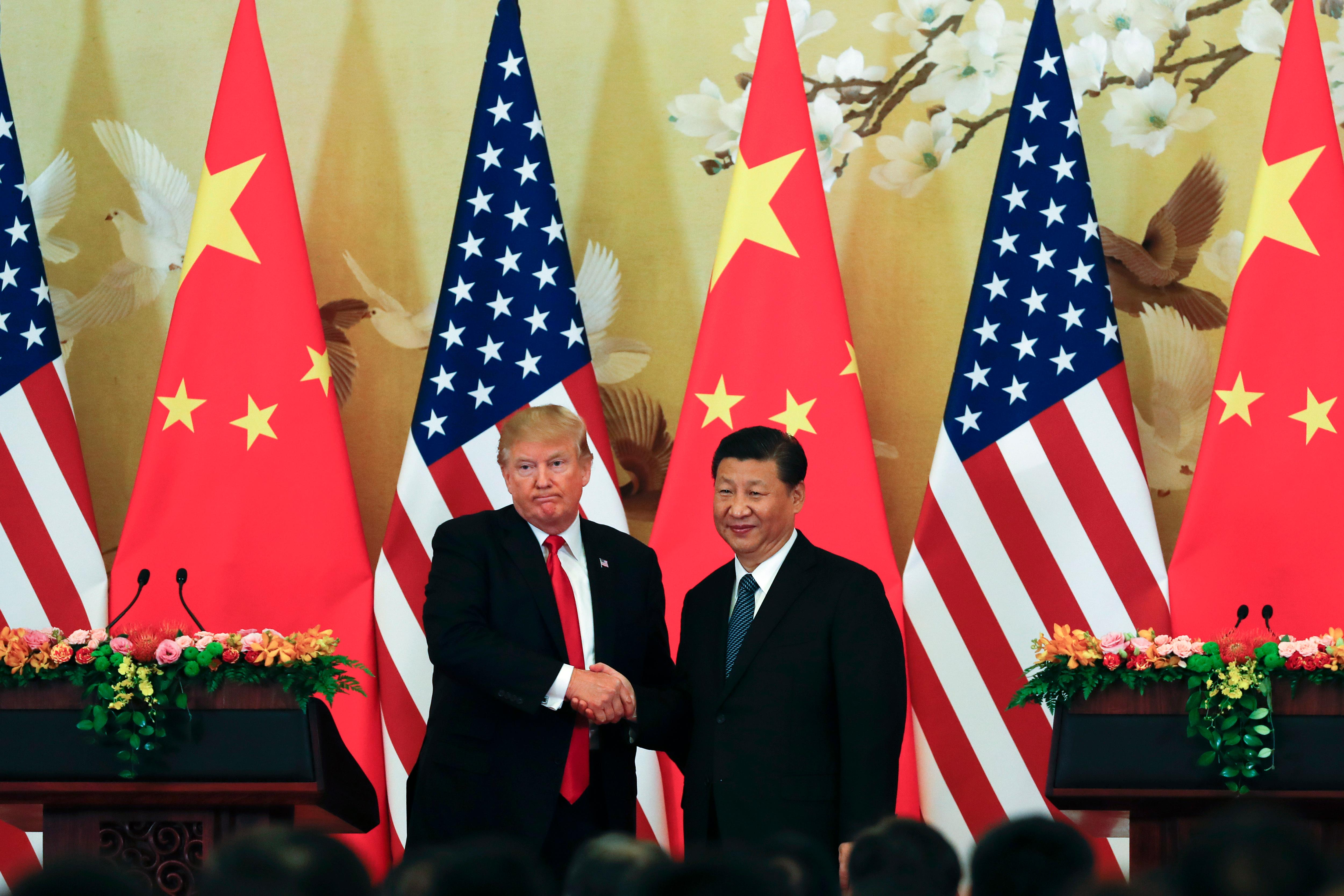 U.S. President Donald Trump, left, poses with Chinese President Xi Jinping for a photo after a joint press conference at the Great Hall of the People in Beijing, Thursday, Nov. 9, 2017. Trump is on a five-country trip through Asia traveling to Japan, South Korea, China, Vietnam and the Philippines. (AP Photo/Andy Wong)