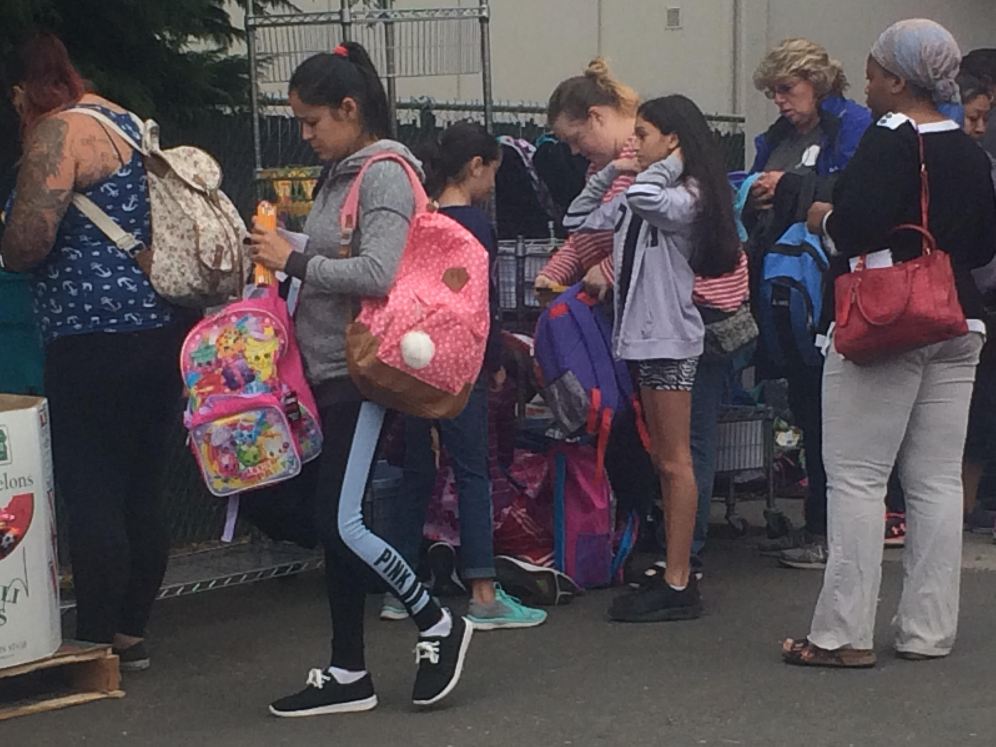 thousands of kids receive backpacks and supplies before