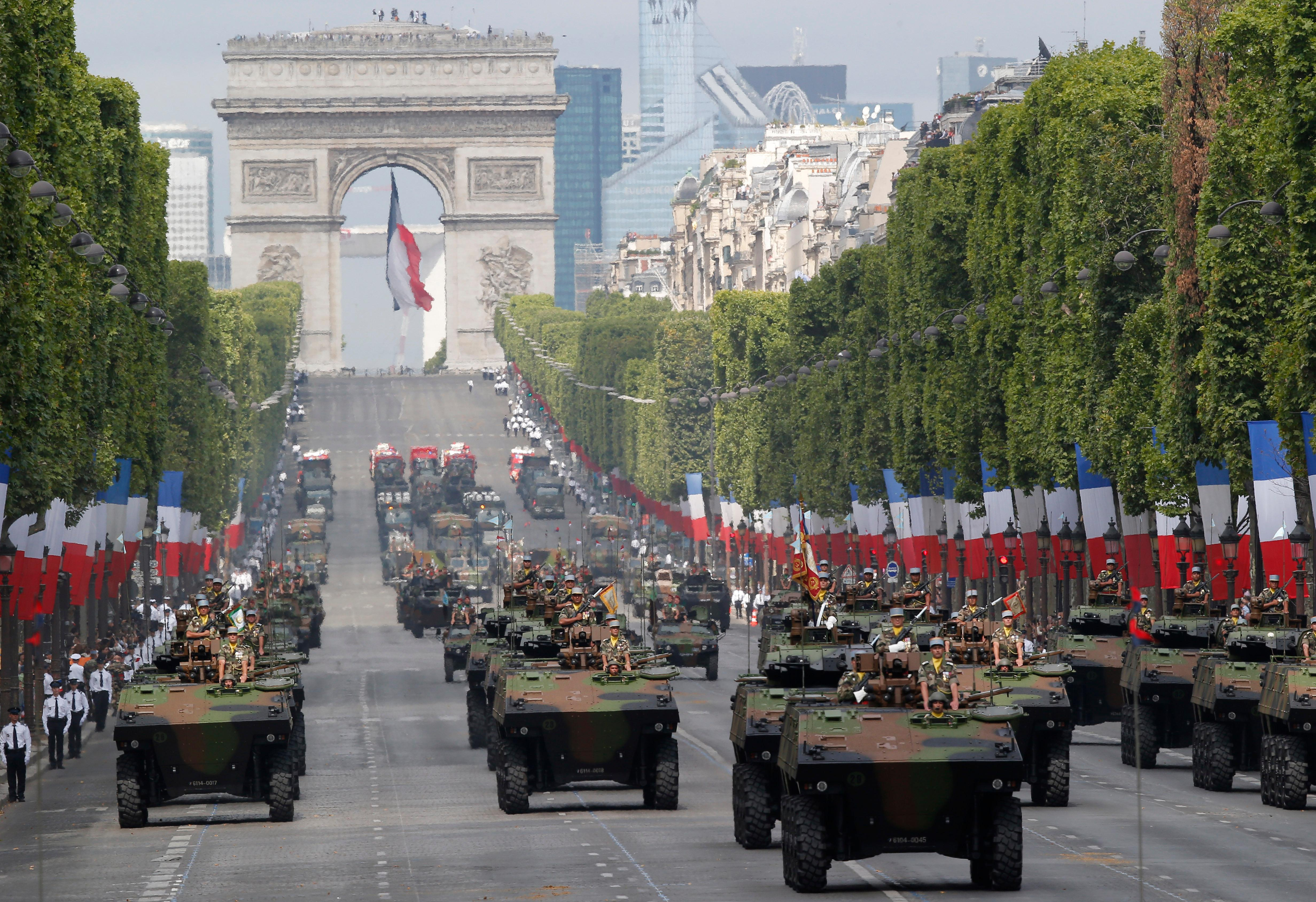 Light armed vehicles drive down the Champs Elysees avenue in Paris, France, as part of Bastille Day parade Tuesday, July 14, 2015. French anti-terrorist forces join the traditional military parade celebrating Bastille Day, as the country's leadership tries to show its muscle against extremists abroad and at home. Mexico's president is the guest of honor at this year's event marking France's biggest holiday. (AP Photo/Michel Euler)
