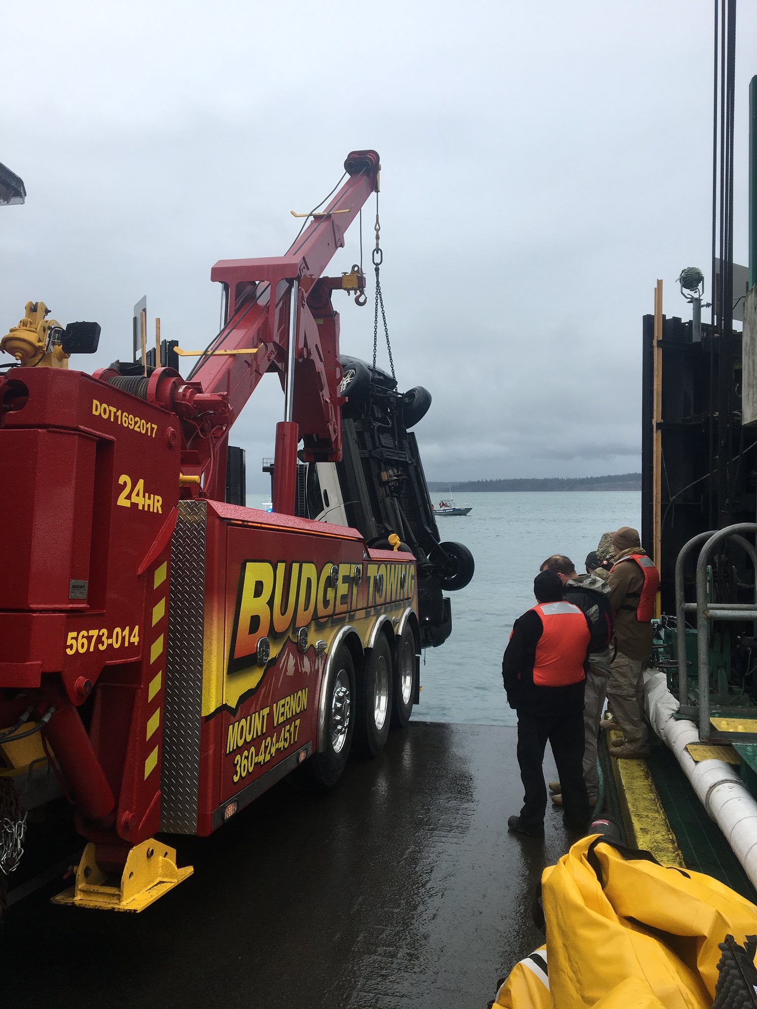 A Jeep is brought up from Puget Sound after it drove off the Anacortes Ferry Dock (Washington State Patrol photo)<p></p>