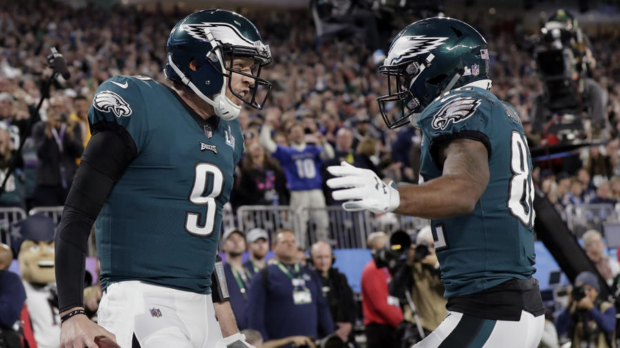 <p>Eagles quarterback Nick Foles (9) celebrates a touchdown with wide receiver Torrey Smith (82), during the first half. (Tony Gutierrez / AP)</p>