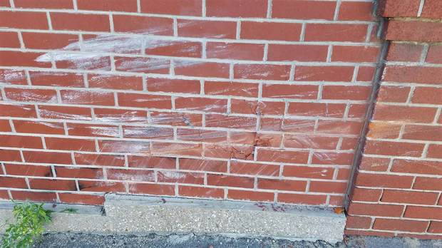 A car driven by Christopher Martin, 33, of Livermore Falls went off Main Street on Wednesday morning in Jay and struck the brick portion of The Scissor Wizard building and bounced off and hit a retaining wall in front of St. Rose Parish Hall, Jay Detective Michael Mejia said. (JAY POLICE DEPARTMENT)